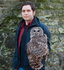 Fabian de Kok-Mercado holds a barred owl.
