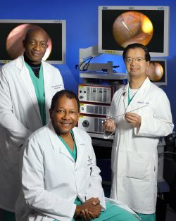 Hopkins endoscopists Patrick Okolo, Tony Kalloo (seated) and Zhiping Li