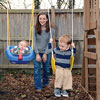 Meredyth Croteau pushing her sons on swings