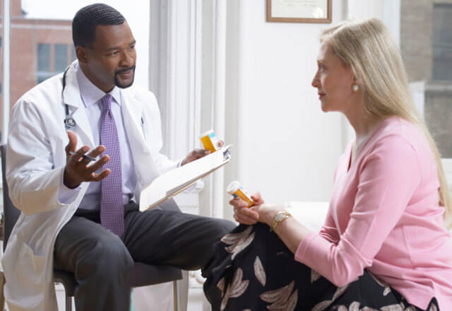 Suburban doctor discusses care with behavioral health patient