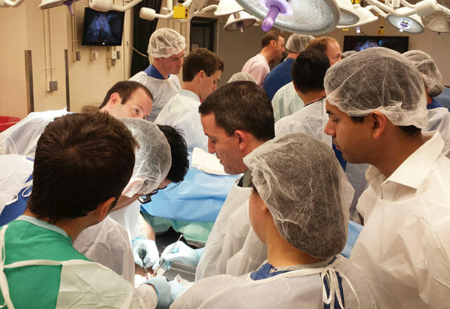 Medical fellows assisting and observing surgery