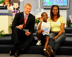 Telethon co-host Steve Jerve of WFLA News chats with ACH patient Justin and his mom, Pethy.