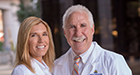 Dr. Miller and Dr. Rothman smiling together in white coats