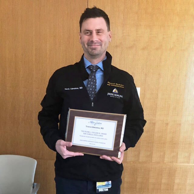 Travis Edmiston with his Award for Clinical Excellence