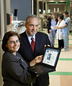 Hanan Aboumatar and Mark Cochran display a perioperative handoff protocol that Hopkins is marketing to health care providers.