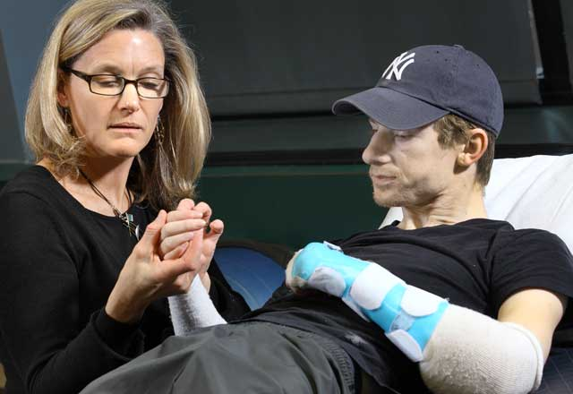 hand transplant recipient with his nurse