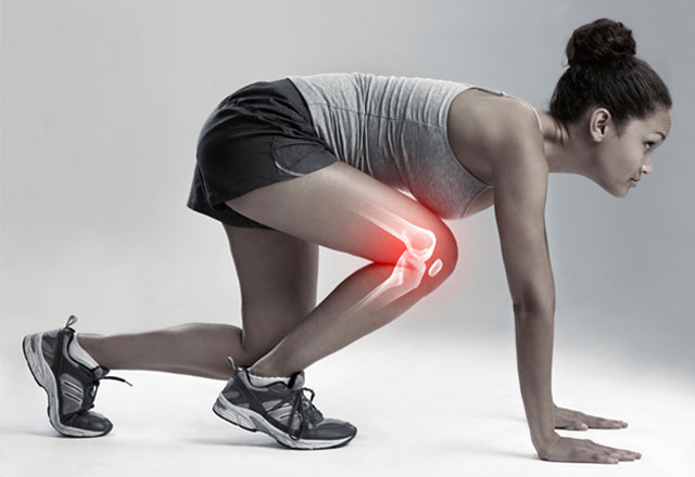 female athlete in a running stance with knee anatomy highlighted
