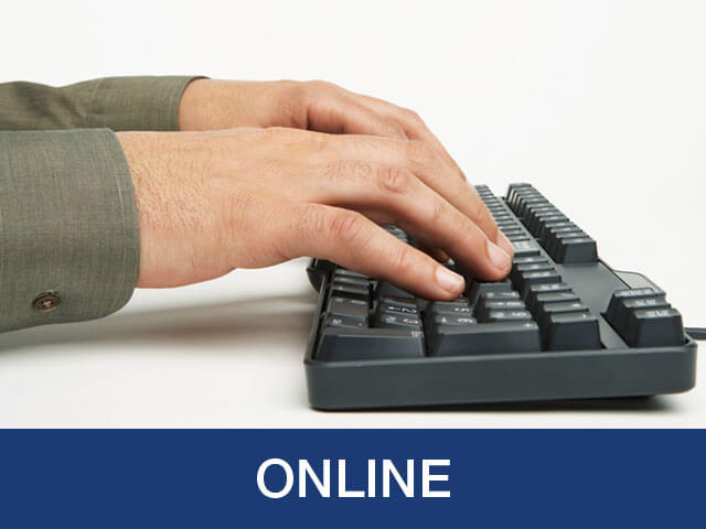 A man typing on a computer keyboard