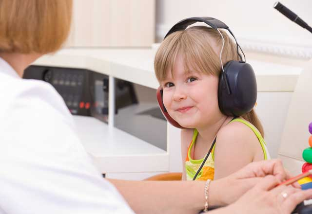Young child undergoes hearing testing comfortably
