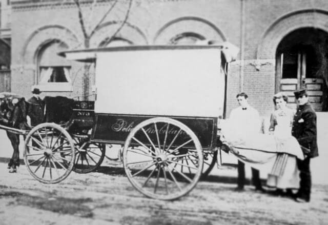 Ambulance beside the original Sibley building