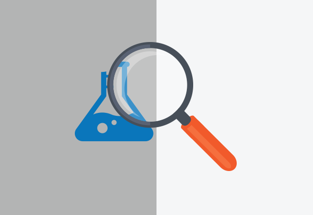 illustration of a magnifying glass over a beaker