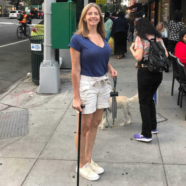 Gay walking in New York City with cane