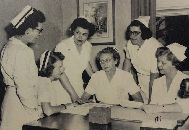 A black and white image of nurses