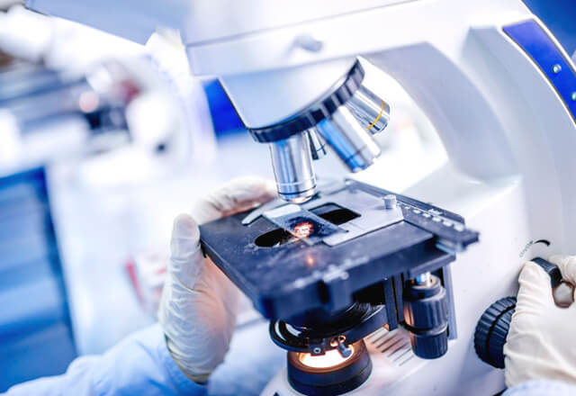 Clinical Trial testing under microscope