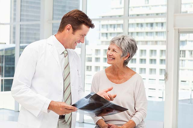 Doctor and patient discussing lung cancer scans