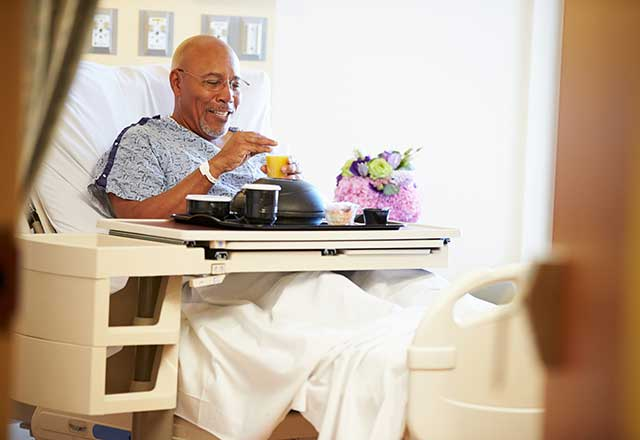 Patient eating in hospital bed