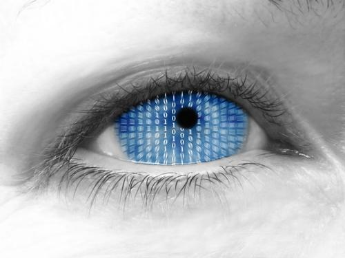 Close up of eye with binary code inside