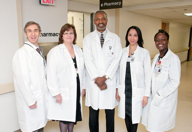 Group of Pharmacists standing and smiling