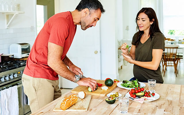 Couple cooking a healthy meal together.