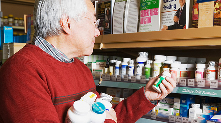 Senior male peruses the vitamin aisle
