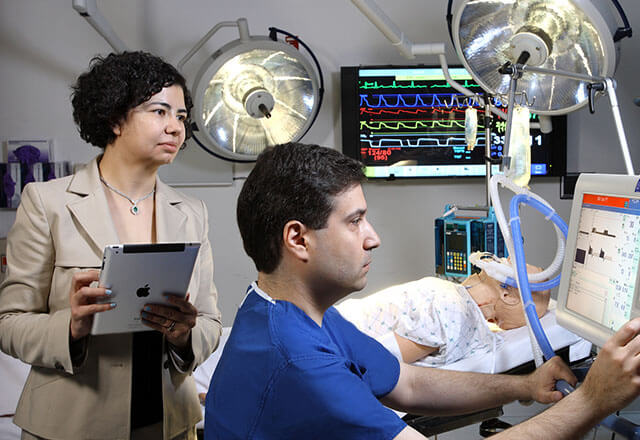 a human factors engineer observing how a clinical worker uses technology
