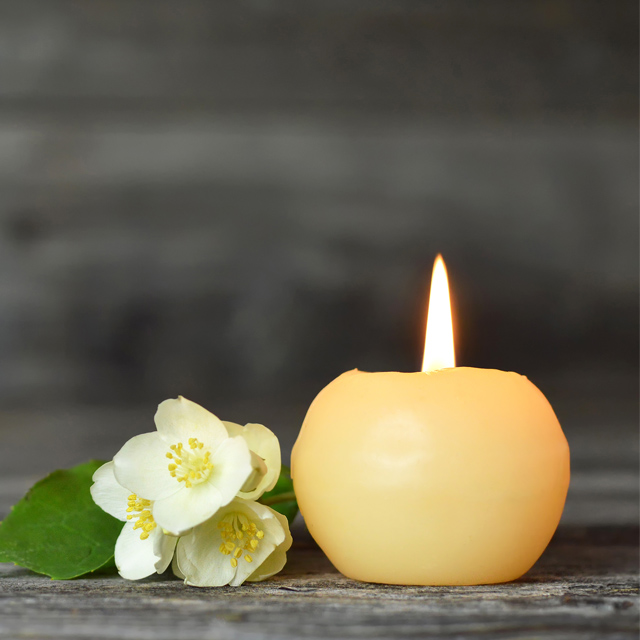 candle and flower memorium