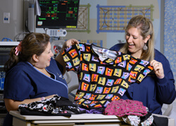 Clinical attire in styles and colors no longer allowed were among the hundreds of scrubs that poured in during a donation drive led by nurses Kristi Bode and Niki Giddings last spring.
