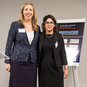 Christy Wyskiel presents Nita Ahuja with an Abell Award