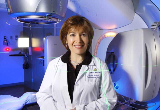 radiologist in front of an MRI