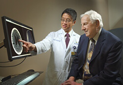 Neurosurgeon David Lin, MD with patient, Richard Suchinsky, MD.