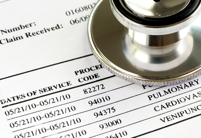 Close-up of medical invoice and stethoscope