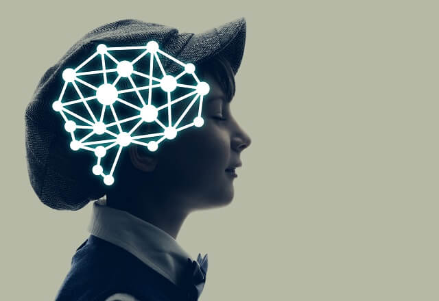 boy in cap with abstract brain connections superimposed