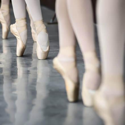 Ballet dancers standing relevé