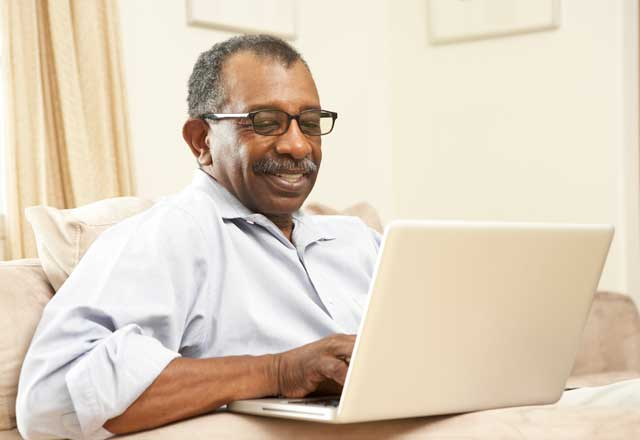 older man on a laptop