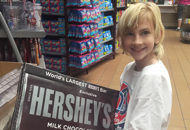 Anderson holds a giant hershey bar