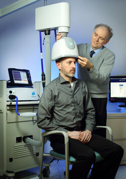 Dr. Reti demonstrates the deep TMS machine