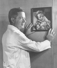 Photo of Dr. Alfred Blalock looking at a blue baby patient.