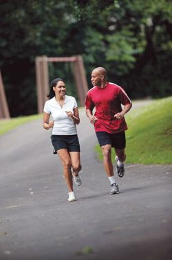african american man and african american woman jogging