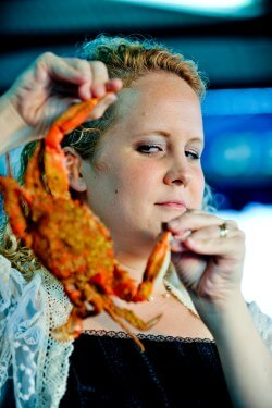 Woman holding a crab