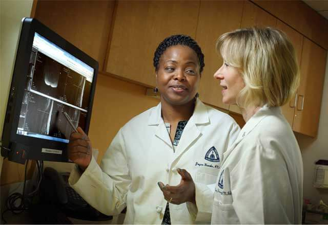 female physicians review a chart together
