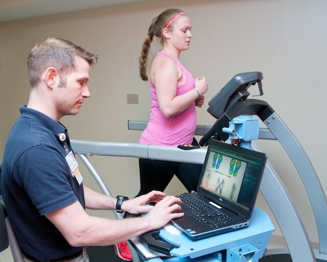Chris Marrow, P.T. and patient on running analysis treadmill