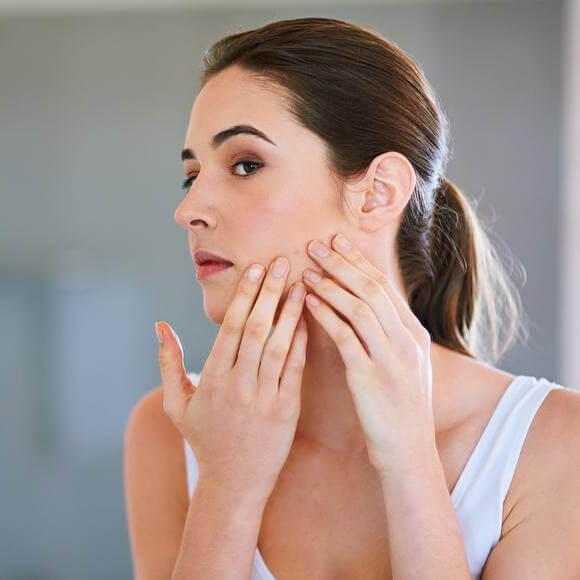 Woman picking at her skin