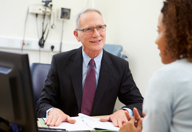 Primary care doctor meeting with a patient