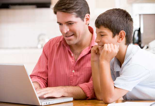 Father and son together at computer