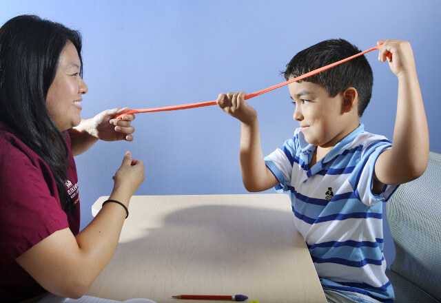 a physical therapist working with a child