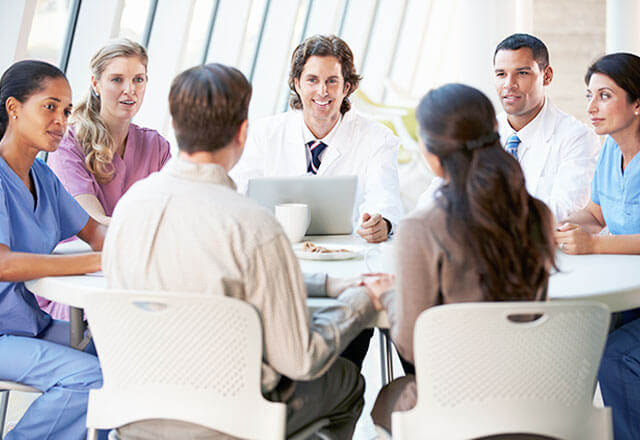 group of physicians around table