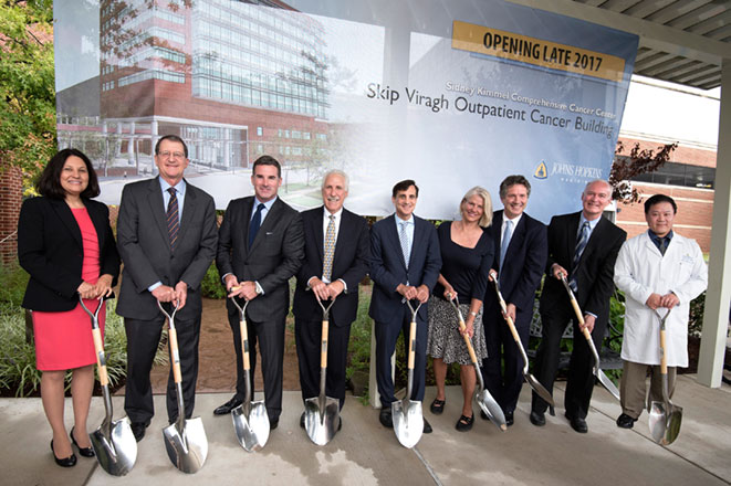 Group holding shovels at Viragh building groundbreaking.