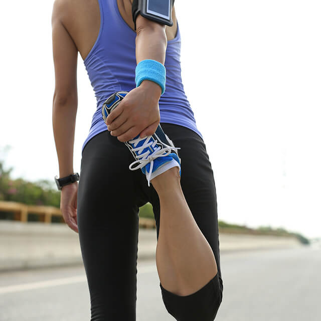 woman stretching before she runs