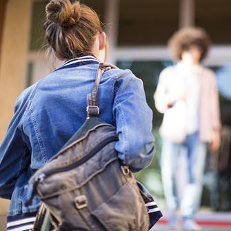 Student walking up school steps.