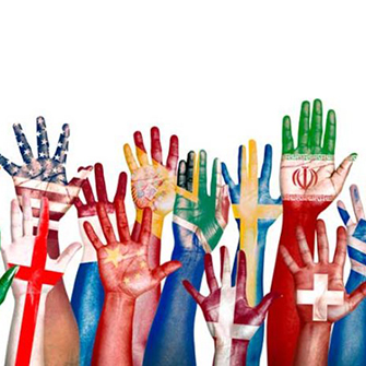 Raised hands painted with world flags.